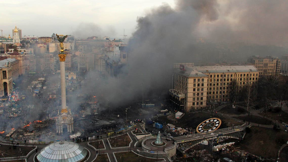 Smoke rises above Independence Square during anti-government protests in central Kiev Feb. 19, 2014.  (Reuters)