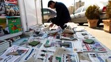 Iran bans new reformist daily, arrests chief