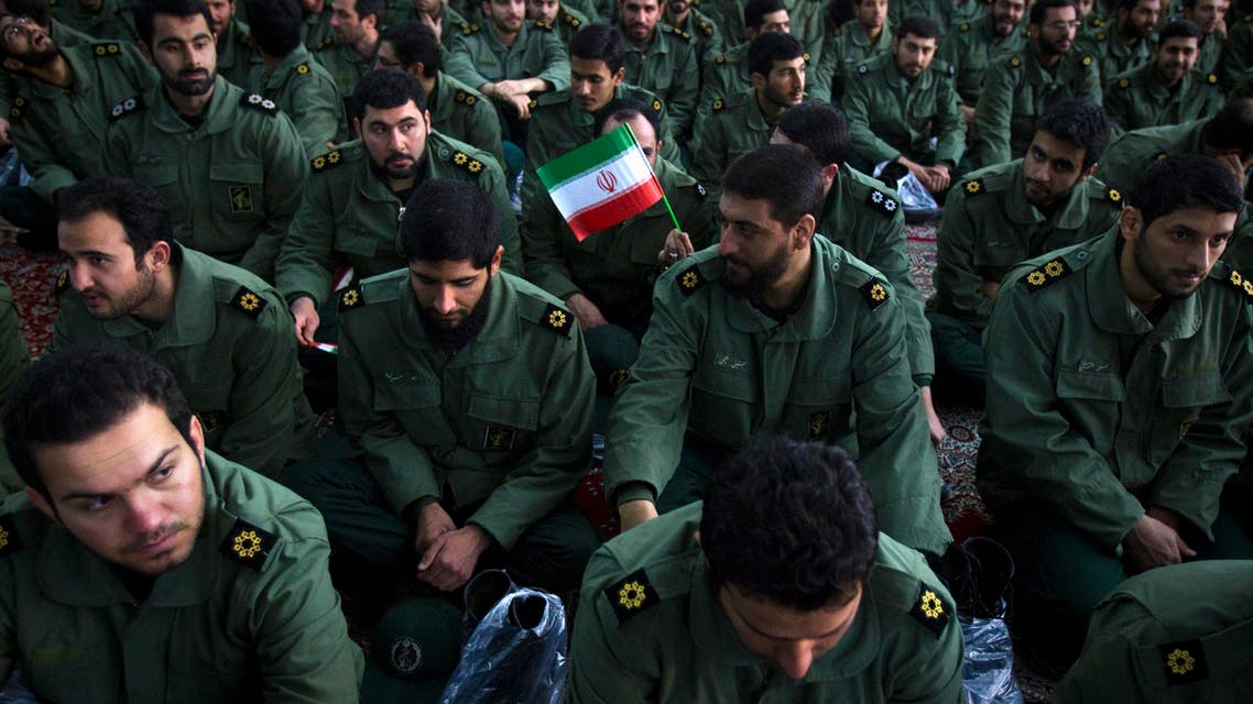 Members of the revolutionary guard attend the anniversary ceremony of Iran's Islamic Revolution at the Khomeini shrine in the Behesht Zahra cemetery, south of Tehran, Feb. 1, 2012. (Reuters)