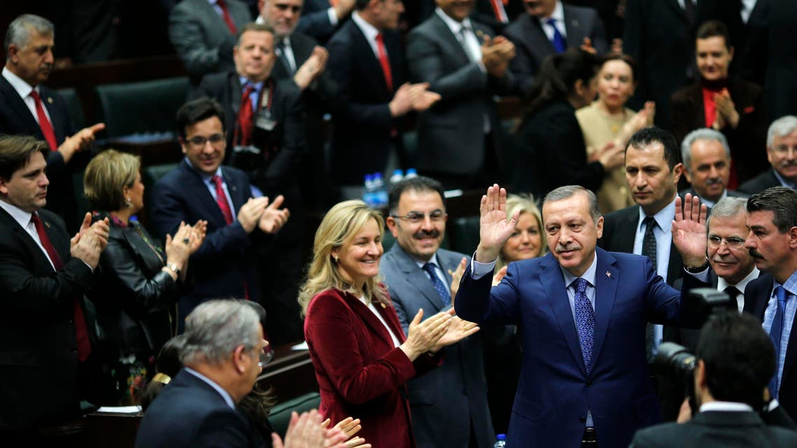Turkey's Prime Minister Tayyip Erdogan greets his supporters as he arrives at a meeting at the Turkish parliament in Ankara Feb. 18, 2014 (Reuters)