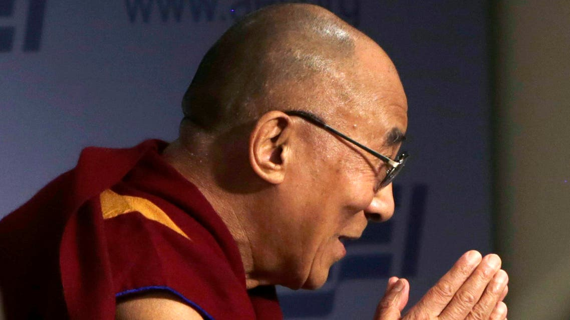 The Dalai Lama greets the audience before addressing the American Enterprise Institute in Washington, Feb. 20, 2014. (Reuters)