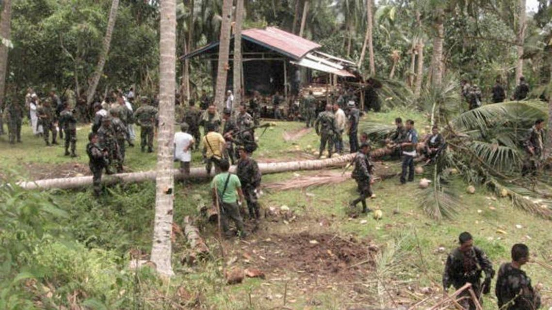 Filipino soldiers gather at a seized camp of Abu Sayyaf militants on Jolo island in southern Philippines September 21, 2009