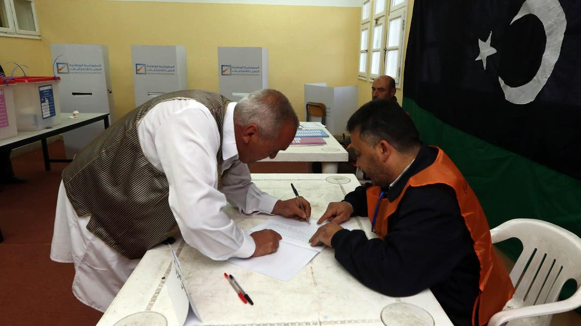 A Libyan man casts his vote to elect a constituent assembly at a polling station in the capital Tripoli on Feb. 20, 2014. (AFP)