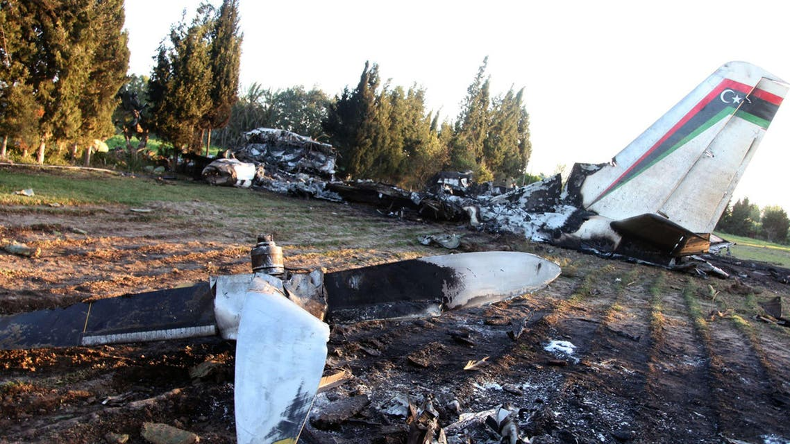 A picture taken on February 21, 2014 shows the wreckage of a Libyan army medical plane that crashed in the Grombalia area, 40 kilometres (25 miles) south of the Tunisian capital, Tunis, killing all 11 people on board.