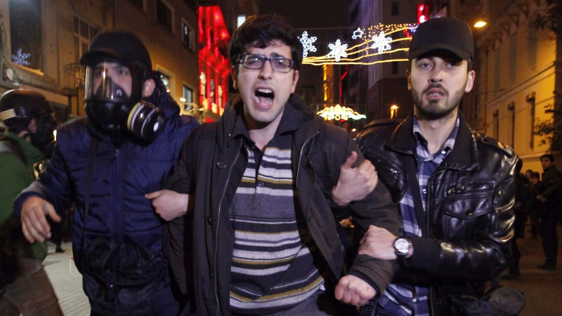 Plain clothes police officers detain a demonstrator during a protest against a new law tightening control of the Internet in Istanbul, Feb. 22, 2014. (Reuters)