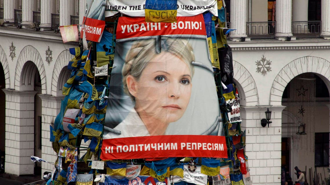 A poster showing jailed Ukrainian opposition leader Yulia Tymoshenko is seen in the Independence Square in Kiev, Feb. 22, 2014. (Reuters)