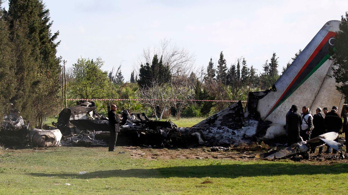 Investigators work at the site of a plane crash near Grombalia town, south of Tunis, Feb. 21, 2014. (Reuters)