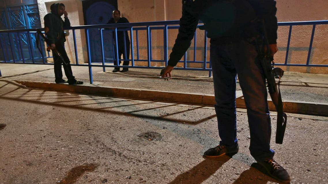 Security personnel are seen outside the Tunisian consulate in Benghazi February 22, 2014.