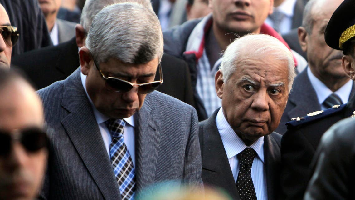 Egypt's Interior Minister Mohamed Ibrahim (L) and Prime Minister Hazem el-Beblawi