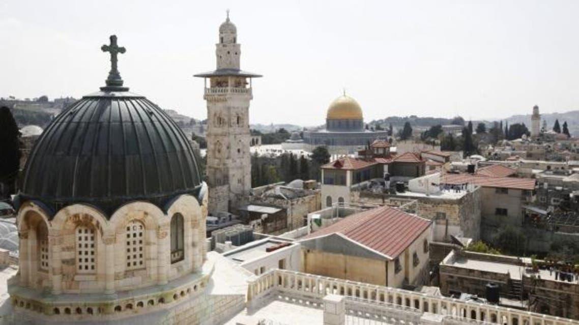 كنيسة القيامة وفي الخلفية الحرم القدسي في القدس المحتلة
