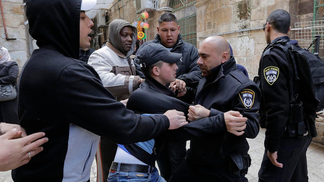 An Israeli police officer scuffles with a Palestinian youth who is trying to enter the compound known to Muslims as Noble Sanctuary and to Jews as Temple Mount in Jerusalem's Old City February 25, 2014.