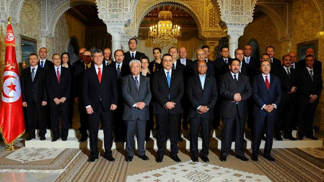 Tunisian President Moncef Marzouki (front row, 3nd R) poses with his government after taking the oath of office at the Carthage Palace in Tunis January 29, 2014