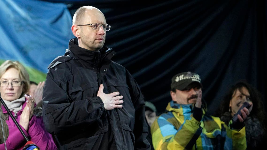 Former economy minister Arseny Yatseniuk (front) stands on the stage during a rally in Independence Square in Kiev, February 26, 2014. Reuters