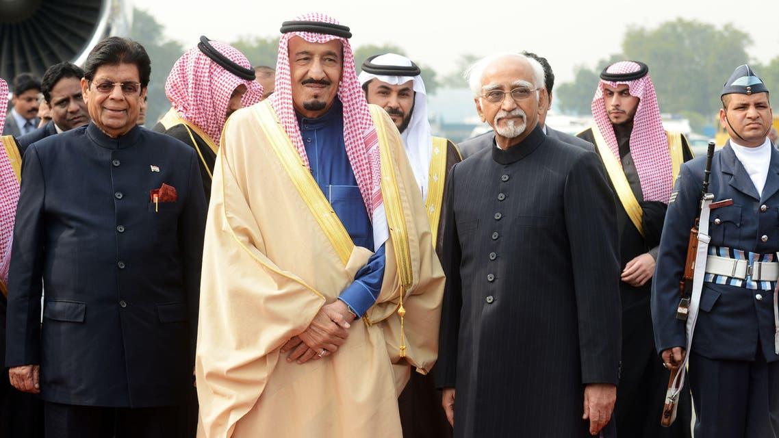 Crown Prince, Deputy Prime Minister and Minister of Defence Salman bin Abdulaziz Al Saud of the Kingdom of Saudi Arabia (C) poses for a photograph with Indian Vice-President Hamed Ansari (R) AFP
