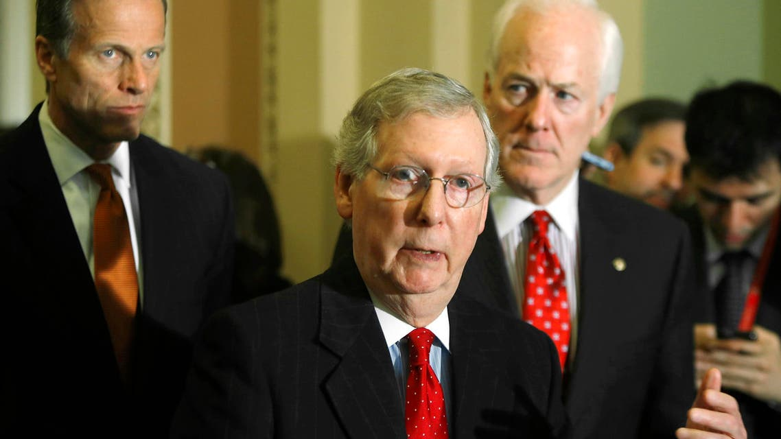 U.S. Senate Minority Leader Mitch McConnell (R-KY) (C) is flanked by Senator John Thune (R-SD) (L) and Senator John Cornyn (R-TX) (R) as he addresses reporters at the U.S. Capitol in Washington, February 4, 2014. (Reuters)