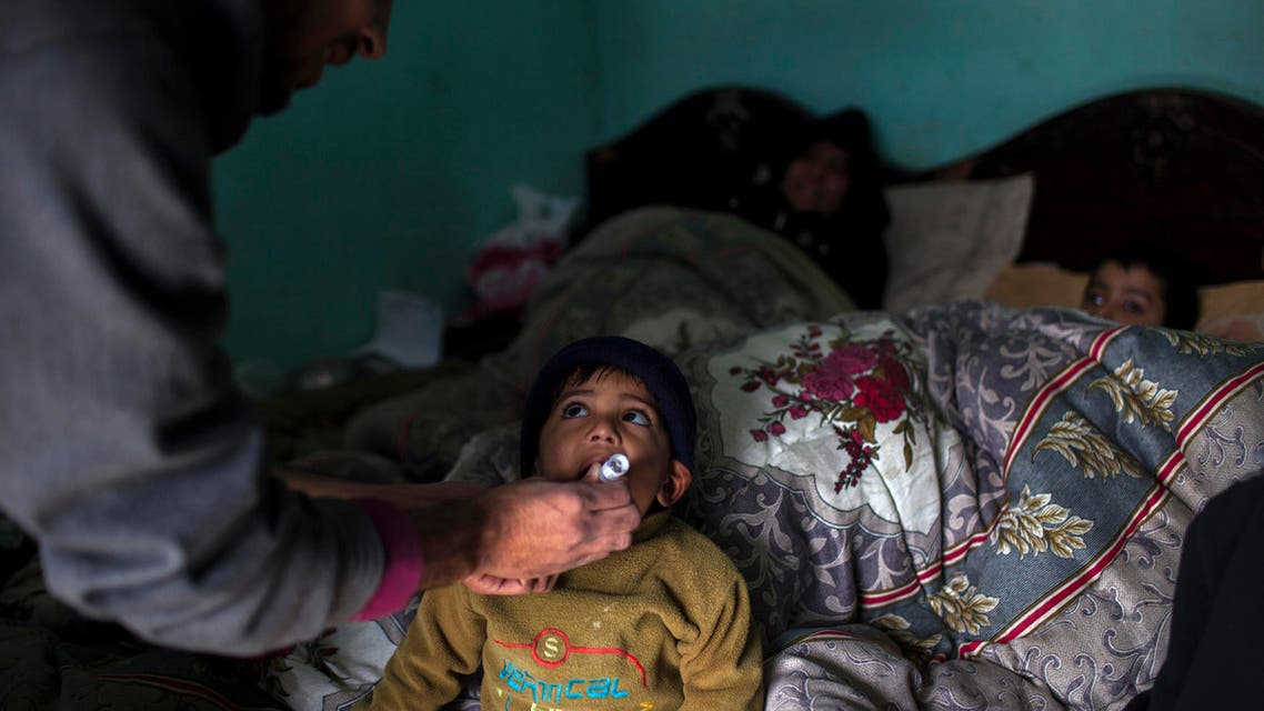 A polio worker gives polio vaccine drops to a child in Islamabad February 26, 2014. reuters