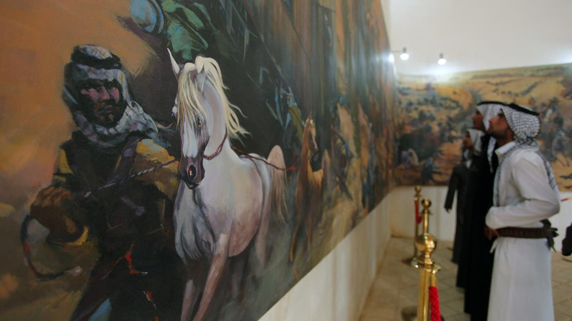 Iraqis visit the Najaf Heritage and 1920 Revolution Museum in the Khan al-Shilan building on February 27, 2014 in the holy city of Najaf, central Iraq. (AFP)