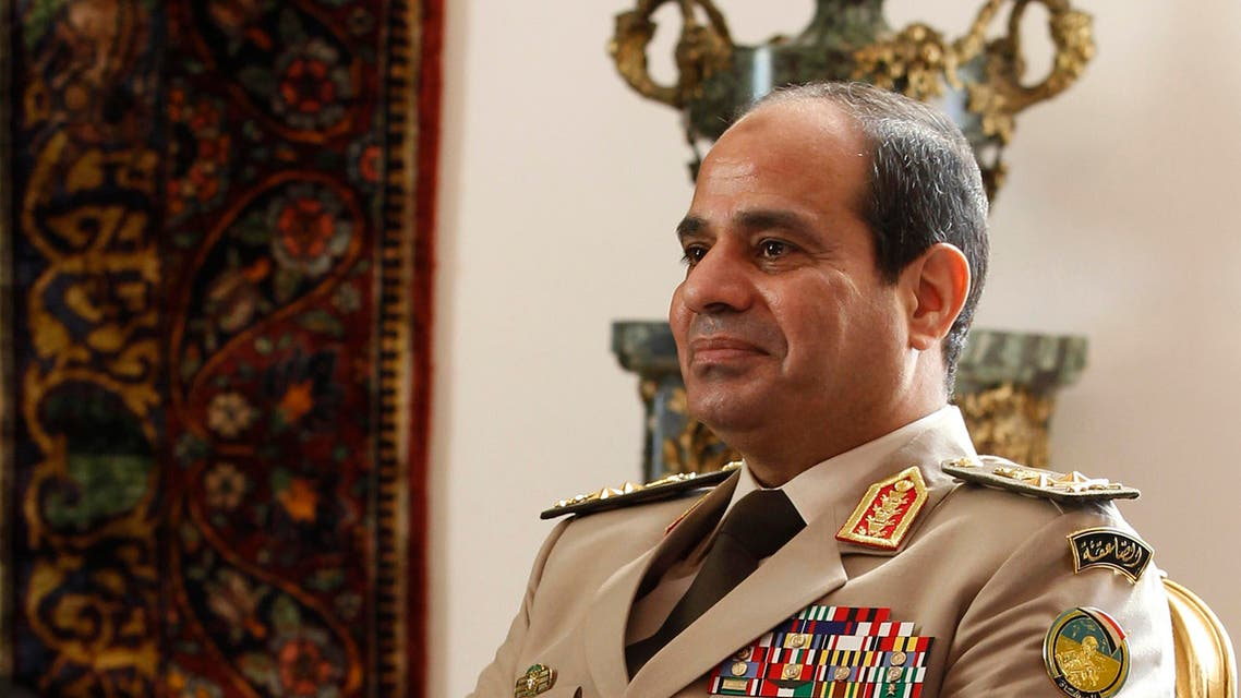 Egypt's Army Chief General Abdel Fattah al-Sisi attends a meeting with Egypt's interim President Adly Mansour