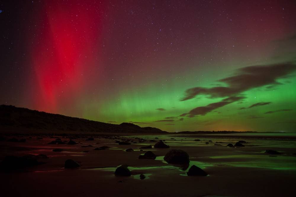 The Northern Lights at Embleton Bay in Northumberland (Picture: PA)