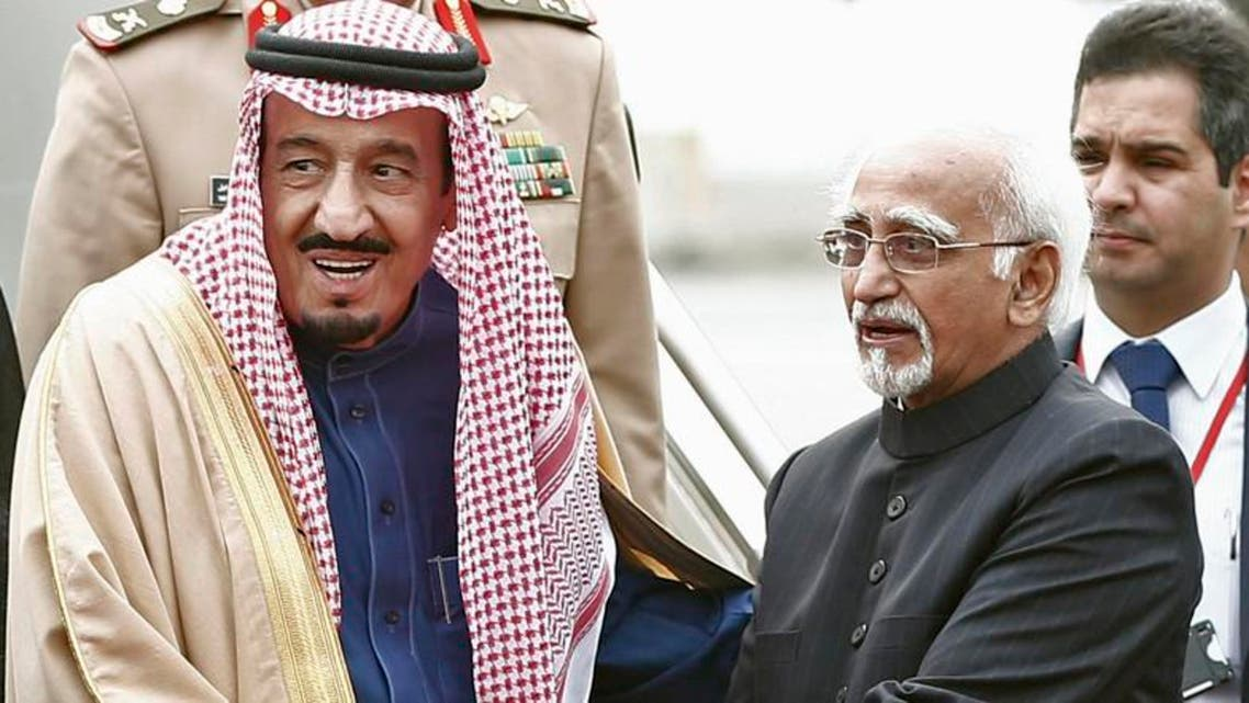 Saudi Arabia's Crown Prince Salman bin Abdul Aziz al-Saud (L) shakes hands with India's Vice President Hamid Ansari upon his arrival at the airport in New Delhi. (Reuters)