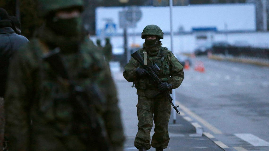 Armed men patrol at the airport in Simferopol, Crimea Feb. 28, 2014. (Reuters)