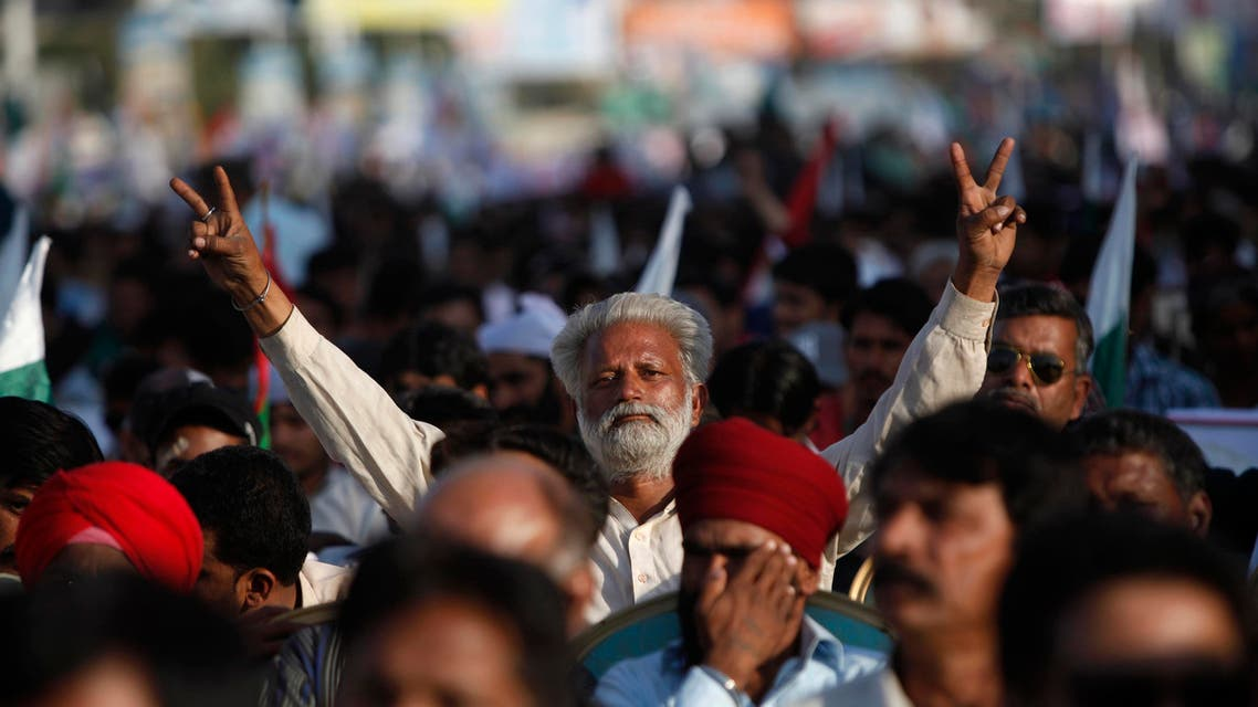 A supporter of Muttahida Qaumi Movement (MQM) political party flashes victory signs during a rally to show their solidarity to Pakistan's Armed Forces in Karachi February 23, 2014.
