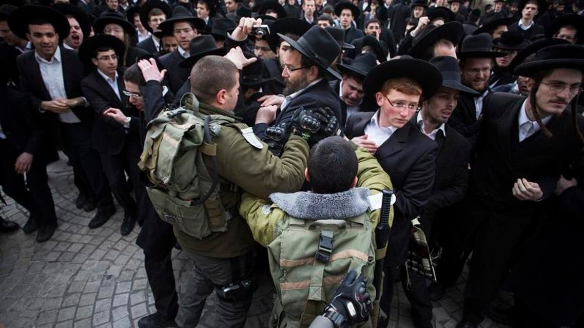 Israeli border policemen scuffle with ultra-Orthodox Jewish protesters during a demonstration in Jerusalem Feb. 6, 2014. (Reuters)
