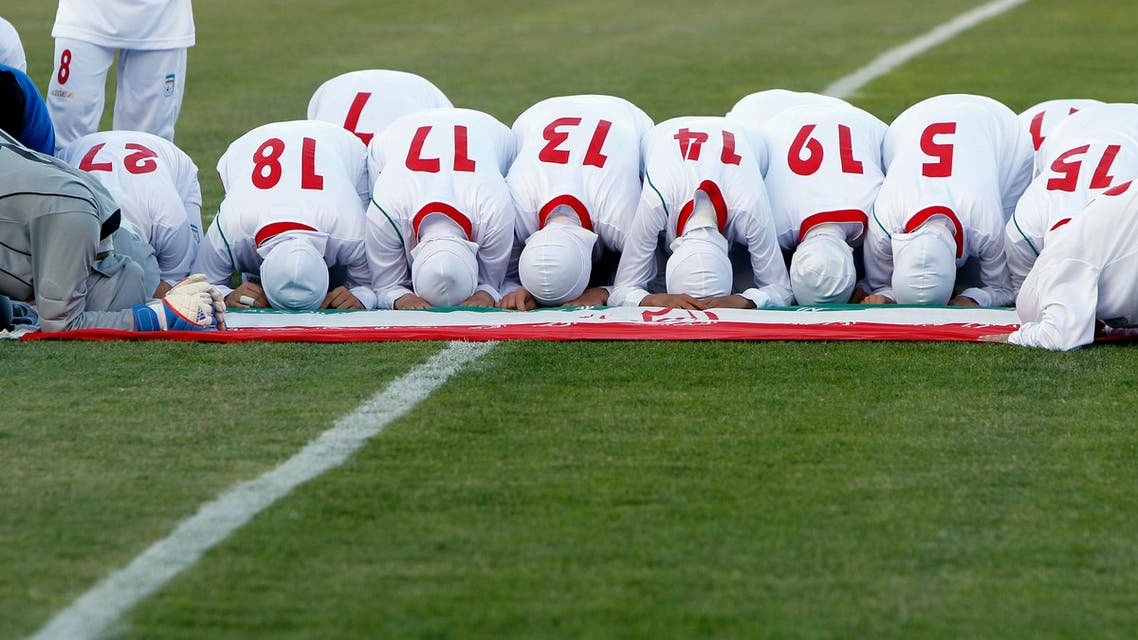 The Iranian women's national soccer team pray after withdrawing from their qualifying match against Jordan for the 2012 London Olympic Games reuters