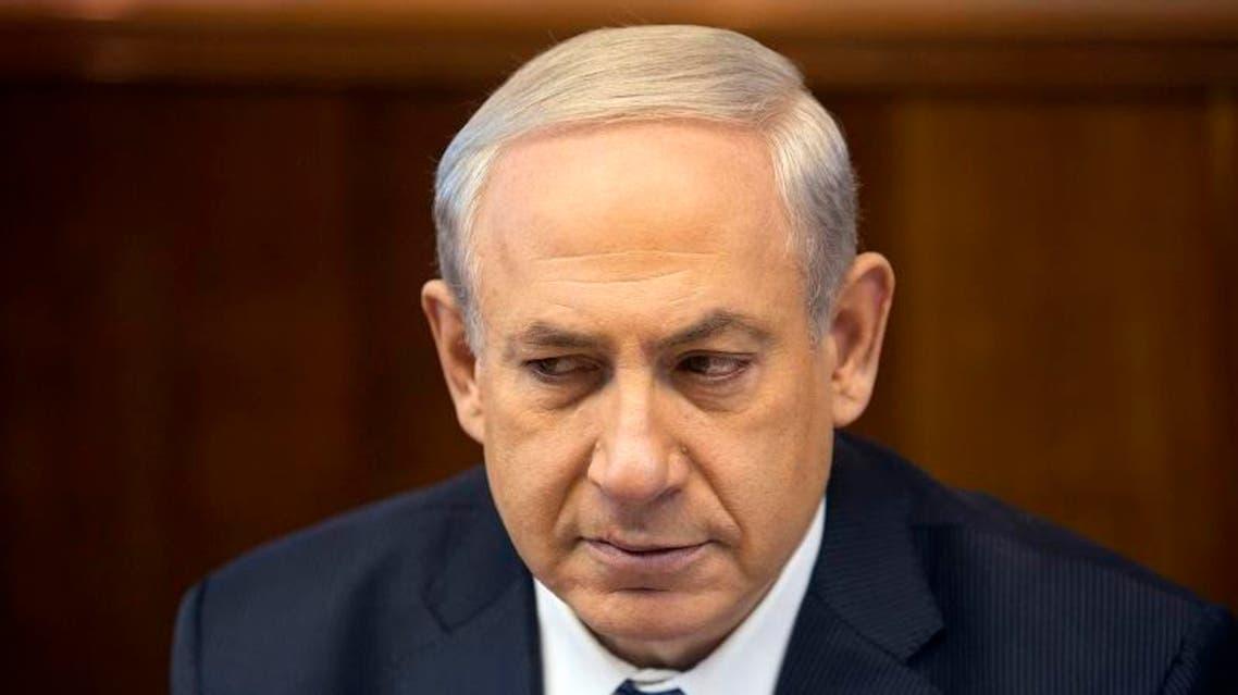 Israel's Prime Minister Benjamin Netanyahu attends the weekly cabinet meeting in Jerusalem February 9, 2014.