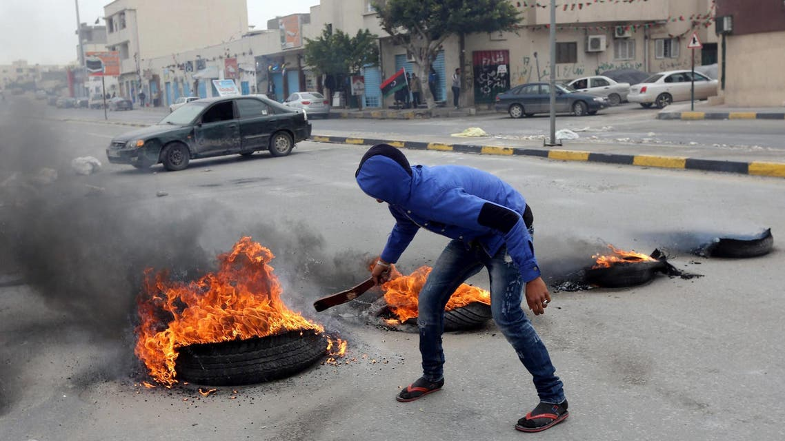 On Sunday, residents blocked roads in the area to demand the release of those held, an AFP photographer said.  According to demonstrators, the gunmen belonged to the Operations Cell of Libyan Revolutionaries, a former rebel group which operates under the GNC's command.  The Congress, elected after the 2011 revolution which ousted Libyan leader Muammar Qaddafi, has stirred popular anger by extending its mandate, which was due to expire in early February, until the end of December.  Under pressure from demonstrators, the GNC has announced that early elections will be held but without setting a date.