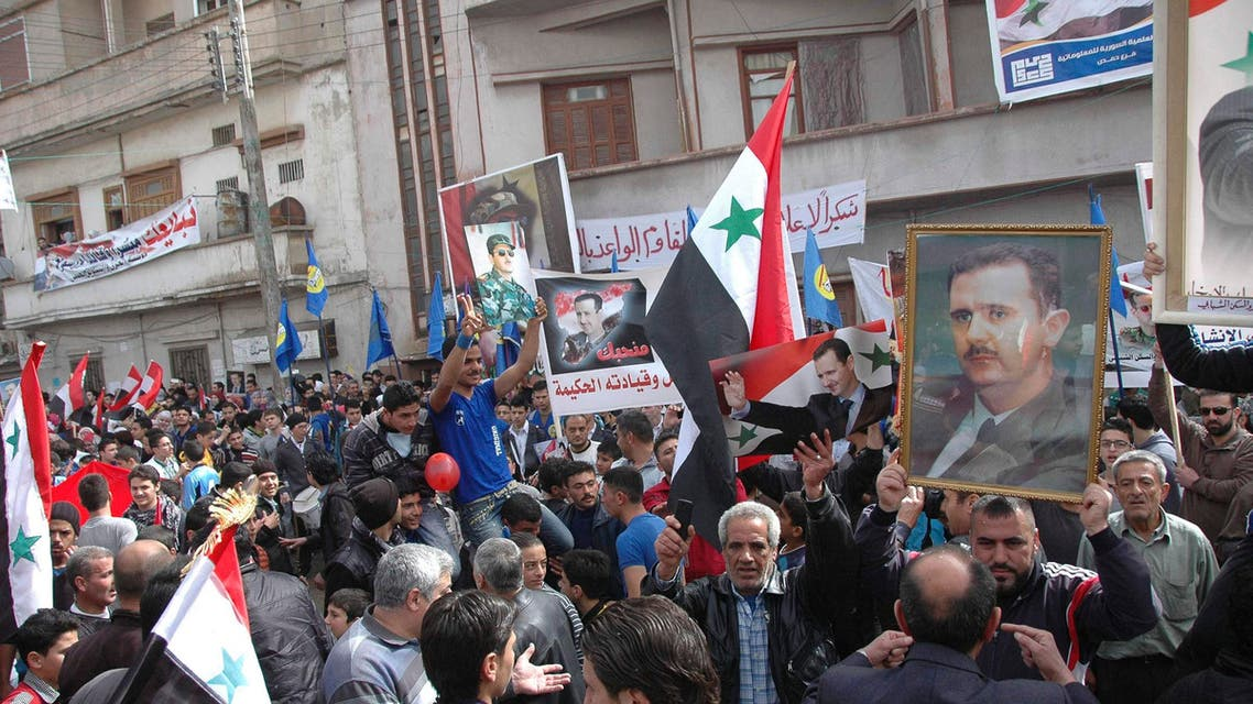 Supporters of Syrian President Bashar al-Assad attend a rally in support of him and the army at the Karm al-Shami neighbourhood in Homs, March 3,2014. (Reuters)