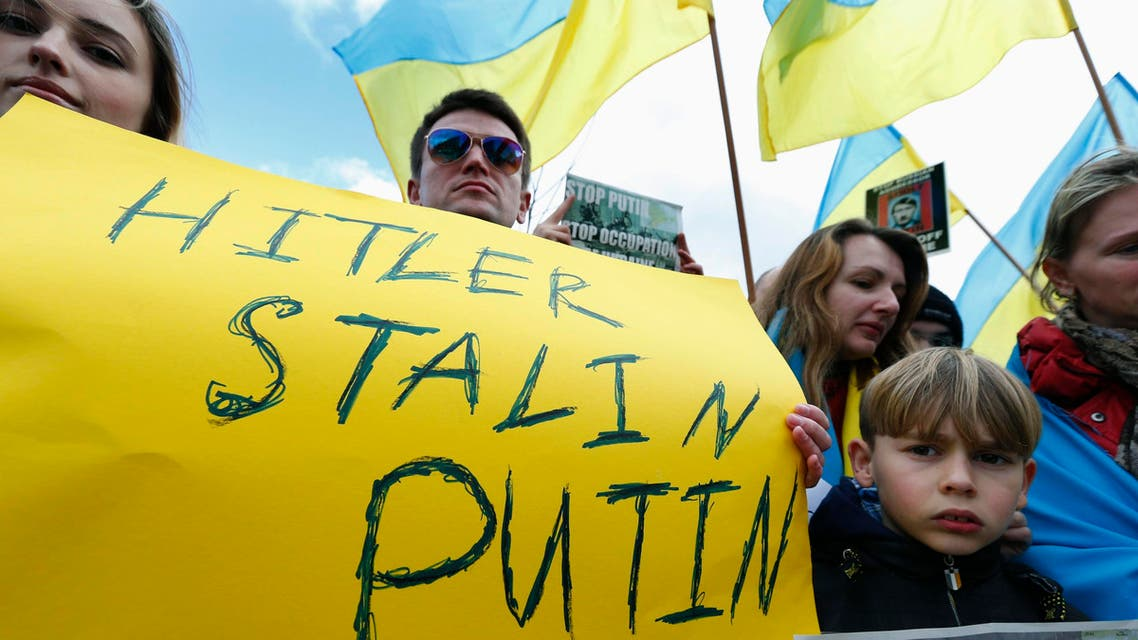 People protesting against Russian troops in Ukraine gather outside an European Union emergency foreign ministers meeting in Brussels March 3, 2014. (Reuters)