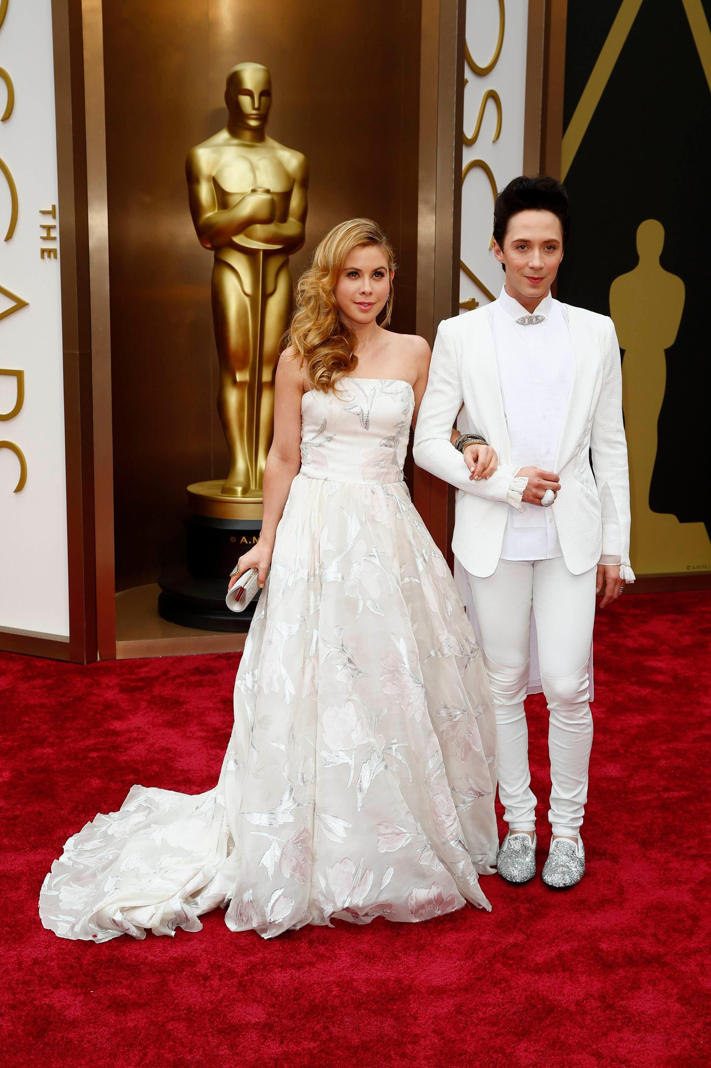 Johnny Weir and Tara Lipinski wearing Rani Zakhem (AFP)
