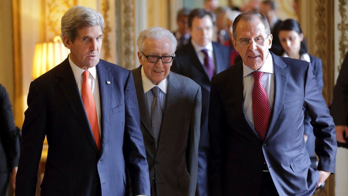 U.S. Secretary of State John Kerry (L), U.N.-Arab League envoy for Syria Lakhdar Brahimi (C) and Russia's Foreign Minister Sergei Lavrov (R) arrive at a news conference at the U.S. ambassador's residence in Paris, January 13, 2014.