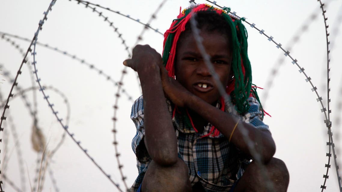 An internally displaced child looks on at the vicinity of an African Union - United Nations Hybrid Operation in Darfur (UNAMID) base near Labado, South Darfur. (File photo Reuters)
