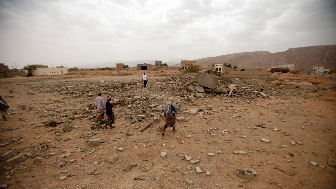 Tribesmen stand on the rubble of a building destroyed by a U.S. drone air strike, that targeted suspected al Qaeda militants in Azan of the southeastern Yemeni province of Shabwa February 3, 2013. (Reuters)