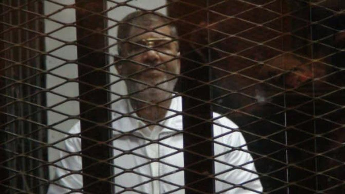 محمد مرسي خلف القضبان