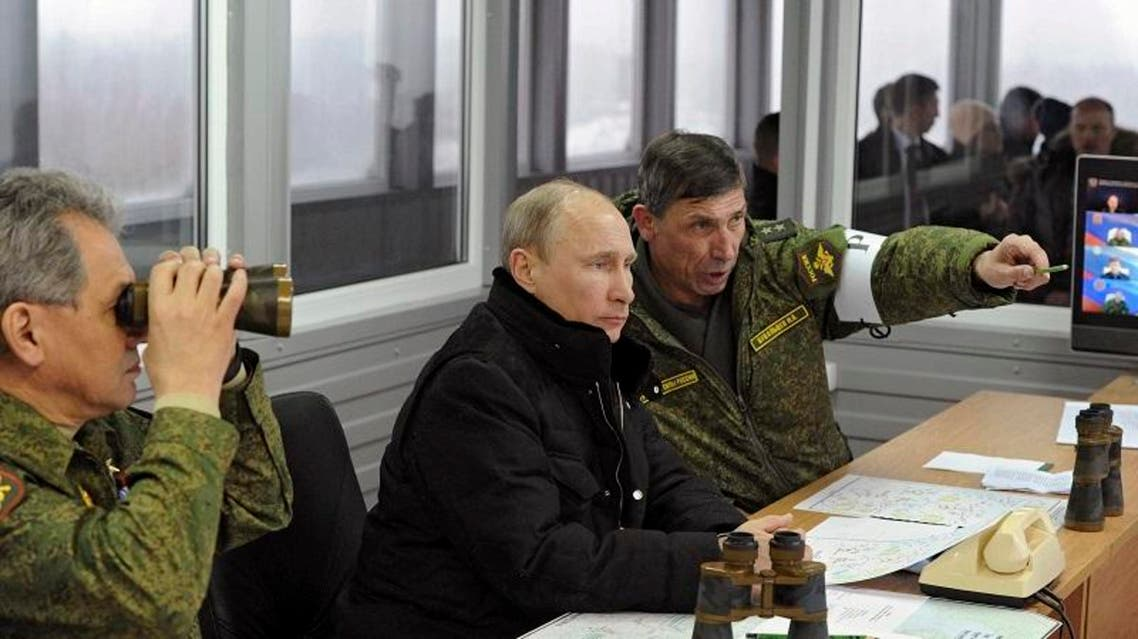 Russia's President Vladimir Putin (C) watched military exercises at the Kirillovsky firing ground in the Leningrad region, March 3, 2014. (Reuters)