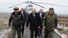 Putin denies Russian forces operating in Crimea