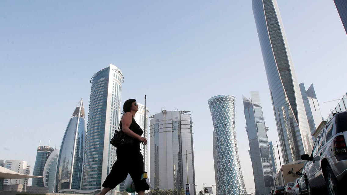 A woman crosses the street in Doha near the headquarters of some of Qatar's biggest firms. (File photo: Reuters)