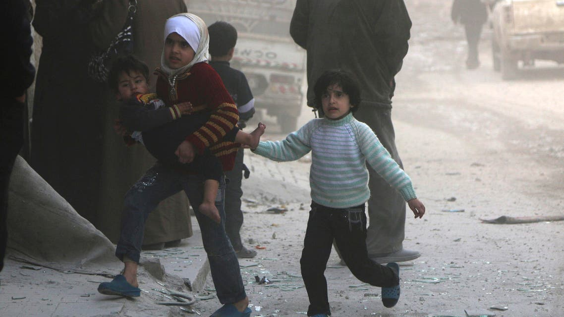 Children walk at a site hit by what activists said was a barrel bomb dropped by forces loyal to Syria's President Bashar al-Assad in Aleppo's al-Sakhour district March 6, 2014. (Reuters)