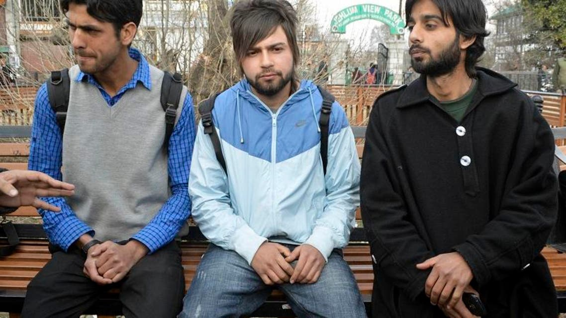 Kashmiri students, who were suspended by a private university in the Uttar Pradesh town of Meerut for cheering for Pakistan during a cricket match against India, speak with the media in Srinagar March 6, 2014.