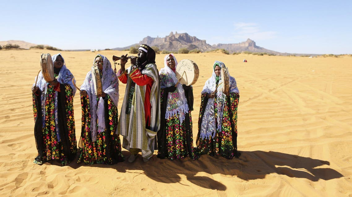 A Tuareg band performs folkloric songs in the desert during the 19th Ghat Festival of Culture and Tourism, in Ghat, about 1,360 km (845 miles) south of Tripoli reuters