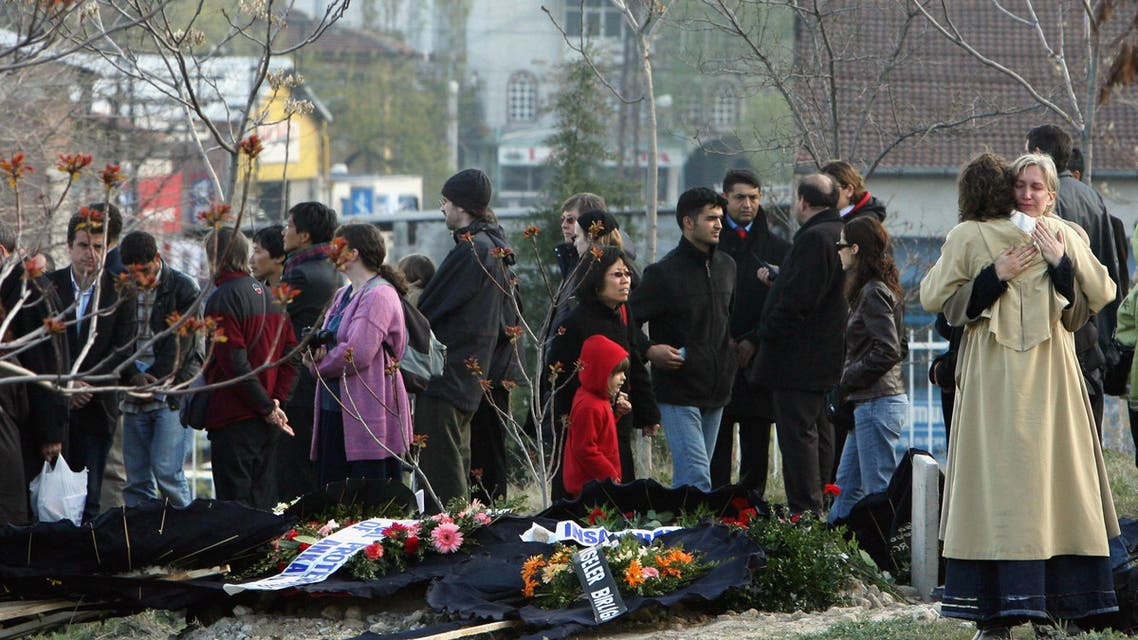 Mourners console one another after the funeral of Tilmann Geske, who was killed in an attack on a publishing house in Turkey's southeastern province of Malatya, at the cemetery in Malatya April 20 2007. Reuters