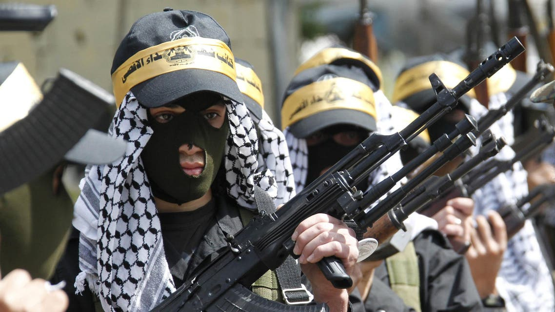 Palestinian Fatah members carry their weapons as they take part in a parade to mark the 65th anniversary of Nakba, at Ain al-Hilweh Palestinian refugee camp. (Reuters)