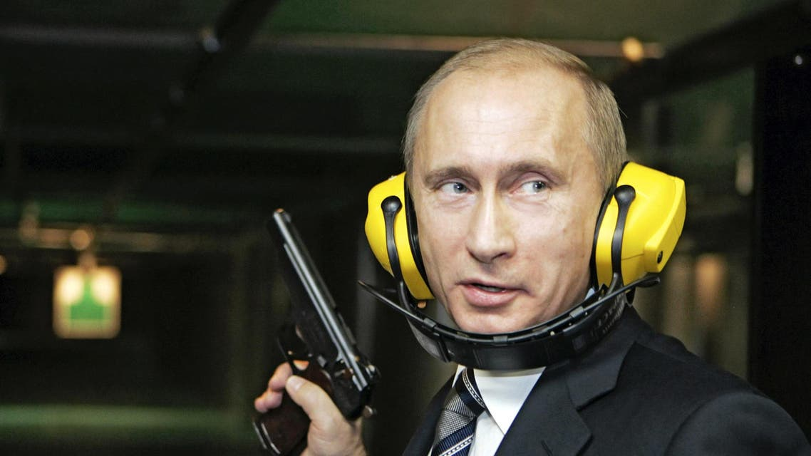 Back in time: Russian President Vladimir Putin stands with a gun at a shooting gallery in Moscow November 8, 2006. (Reuters)