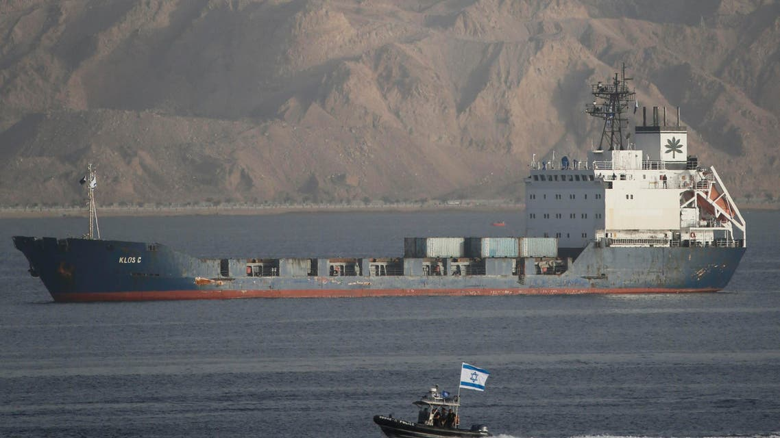 An Israeli Navy boat escorts the Panamanian-flagged cargo vessel Klos C into the Israeli port of Eilat on Saturday after seizing it in the Red Sea on Wednesday, March 8, 2014. (Reuters)