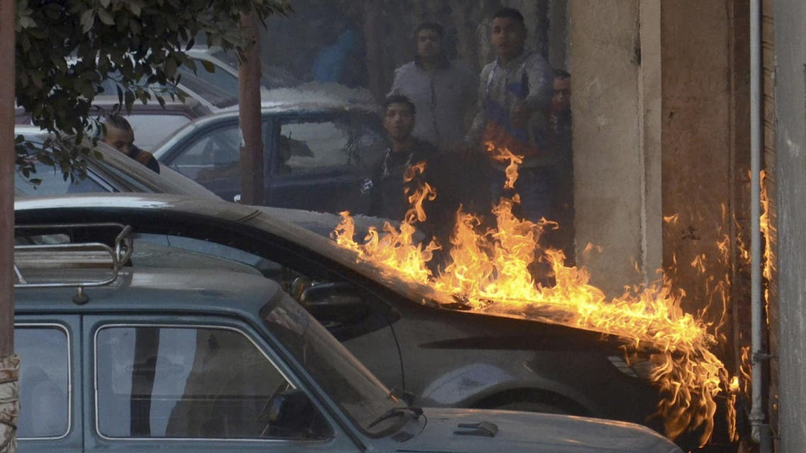 Fire caused by molotov cocktail bombs is seen during clashes between pro and anti-Mursi protesters in the Giza governorate, south of Cairo, February 7, 2014.