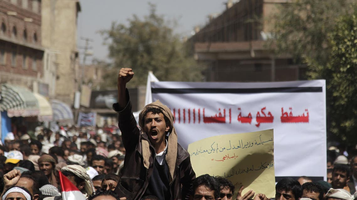 A protester shouts slogans during a demonstration to demand the dismissal of the government in Sanaa March 4, 2014. Reuters