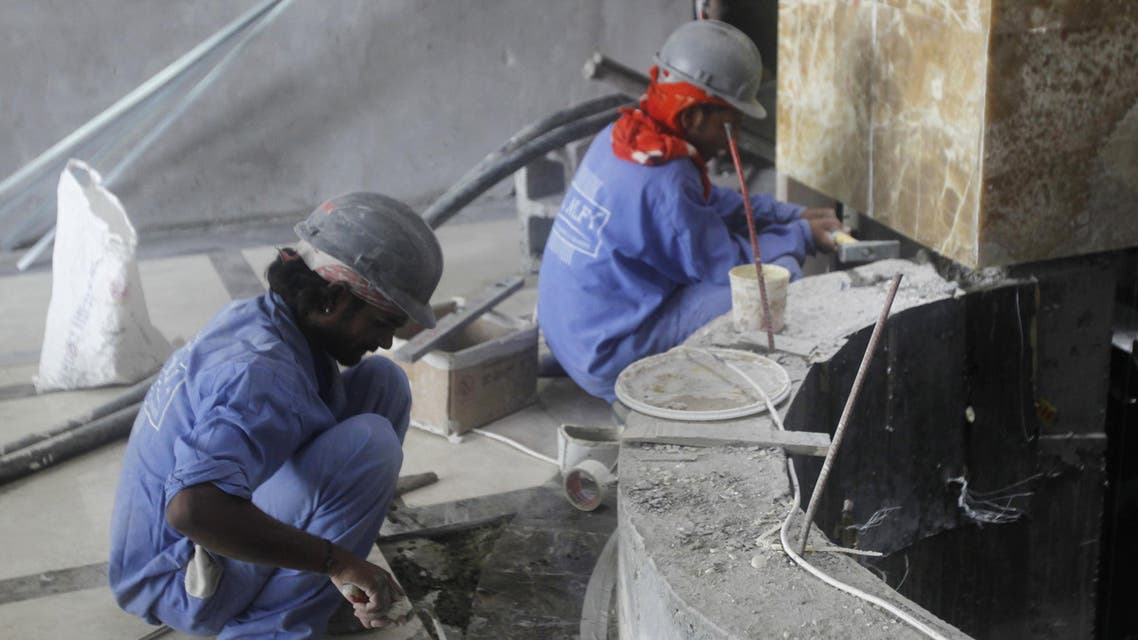 Laborers work at a construction site in Doha on June 18, 2012. (File photo: Reuters)